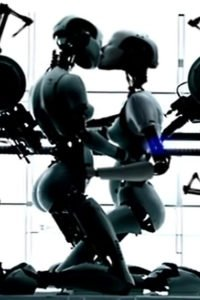 Robot Bjork holding and kissing another Robot Bjork.
