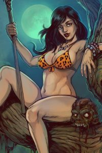 A dark-haired woman in a leopard print bikini top sits on a tree holding a spear.