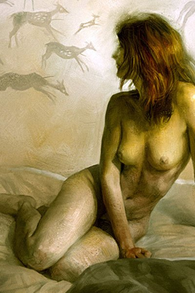 a naked woman sits admiring cave paintings.