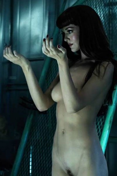 Hannah Rose May as a newly awoken synth.
