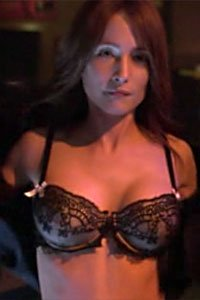 Florentine Lahme as Nadia Schilling from Defying Gravity tearing off her shirt to reveal a lacy black bra.